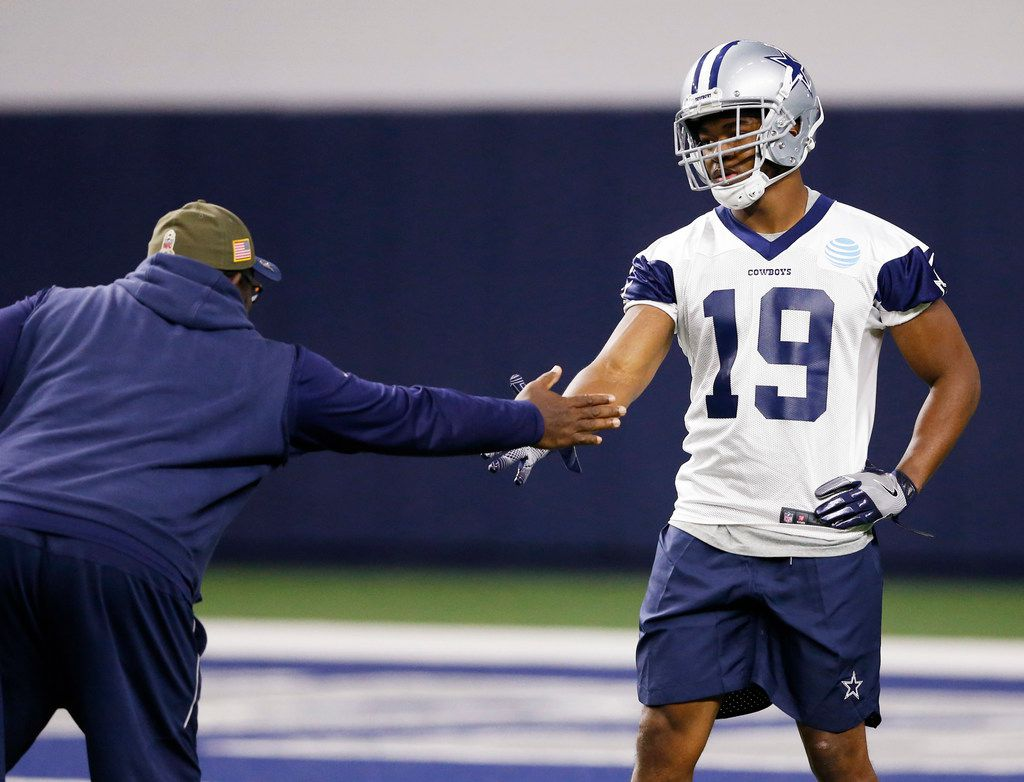 Dallas Cowboys running backs coach Gary Brown greets Dallas Cowboys receiver Amari Cooper (19) before a drill during practice in the Ford Center at the  Star in Frisco on Thursday, October 25, 2018. (Vernon Bryant/The Dallas Morning News)