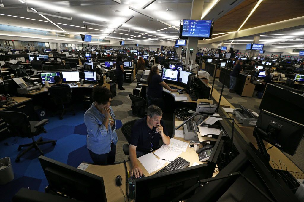 Dale Kerner (righ) and Yolanda Helu work intently at American Airlines' Robert W. Baker Integrated Operations Center, September 15, 2015. (Nathan Hunsinger/The Dallas Morning News) 09162015xPUB