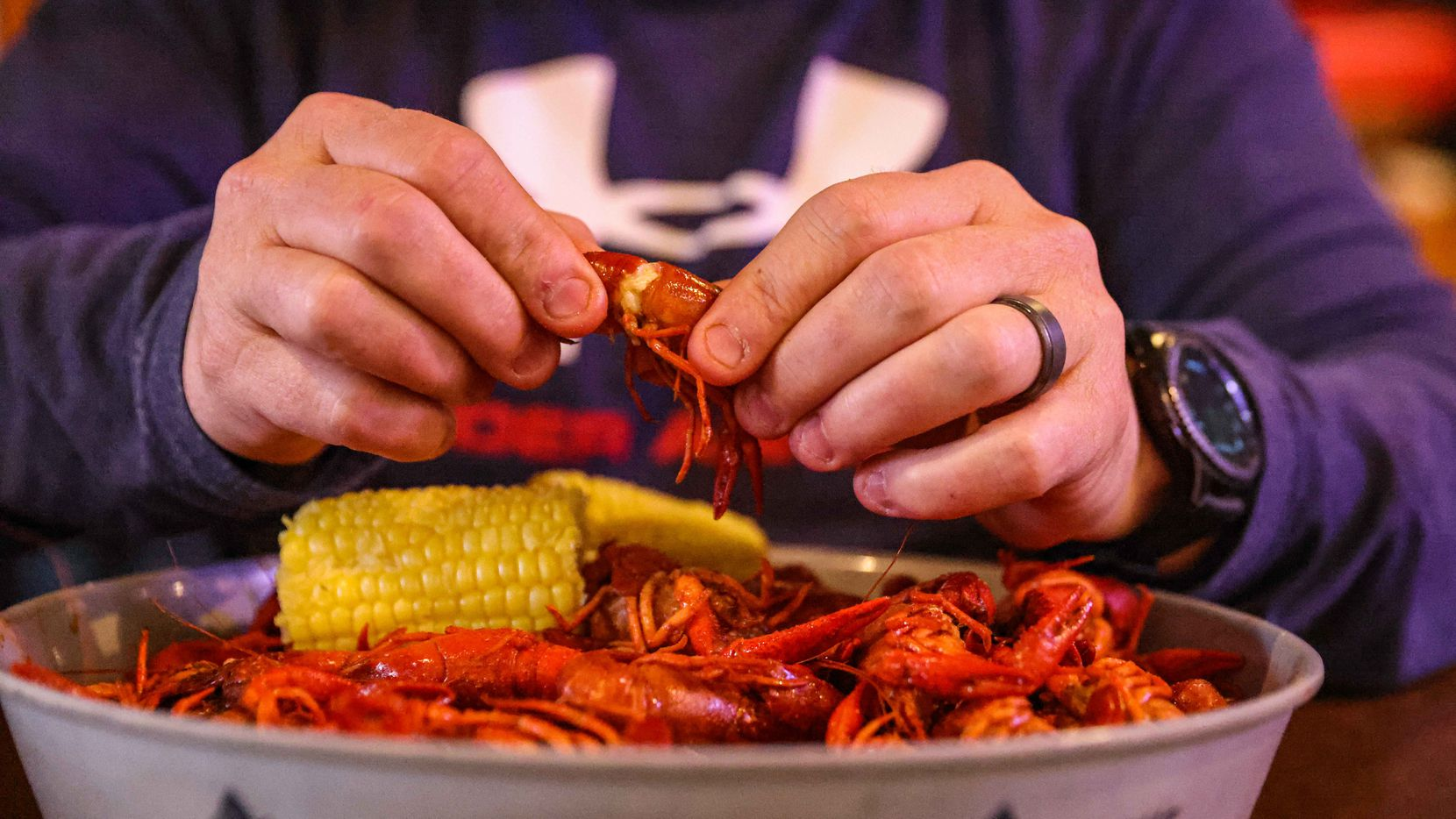 James Freeman removes crawfish meat from its shell during lunch at Big Fish Seafood Grill & Bar in Grapevine. Crawfish is available at nearly every seafood restaurant in Dallas-Fort Worth, but it'll be a strange season because of the coronavirus pandemic.