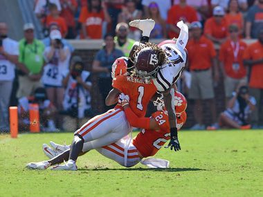FILE - Texas A&M wide receiver Kendrick Rogers (top) is tackled by Clemson cornerback Derion Kendrick (1) and safety Nolan Turner during the first half of a game on Saturday, Sept. 7, 2019, in Clemson, S.C. (AP Photo/Richard Shiro)