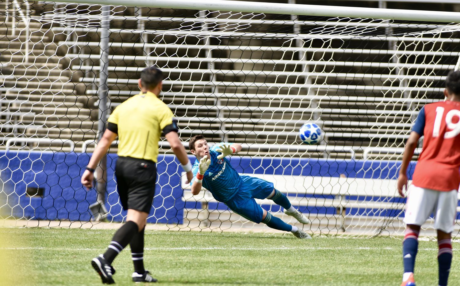 Michael Collodi dives to his right to save a penalty kick against Red Bull Brasil in the 2019 Dallas Cup at the Cotton Bowl. (4-17-19)