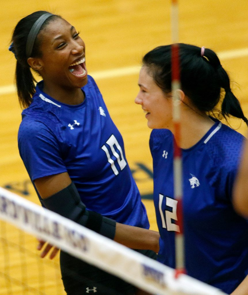 Trophy Club Byron Nelson outside hitter Charitie Luper (10) revels in the moment as she celebrates a kill with teammate Payton Chamberlain (12) during the first game of their match against Denton Guyer. Byron Nelson won in straight sets, 25-18, 25-17, 25-16 to advance to the state tournament. The two teams played their Class 6A Region l championship volleyball match at W.G. Thomas Coliseum in Haltom City on November 16, 2019. (Steve Hamm/ Special Contributor)