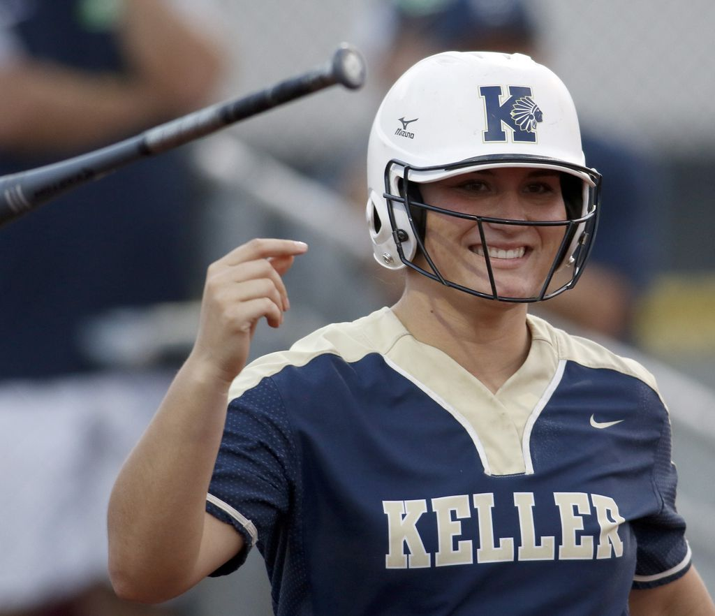 Keller catcher Hayden Brown was all smiles as she tosses the bat after drawing a walk during a game against Northwest Eaton last season. (Steve Hamm/ Special Contributor)