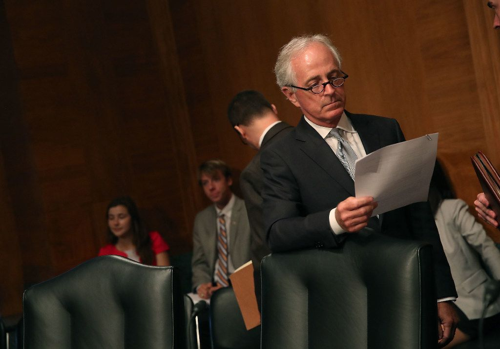 Sen. Bob Corker, R-Tenn., looked over his papers during a Senate Banking, Housing and Urban Affairs Committee hearing on Capitol Hill on June 6.