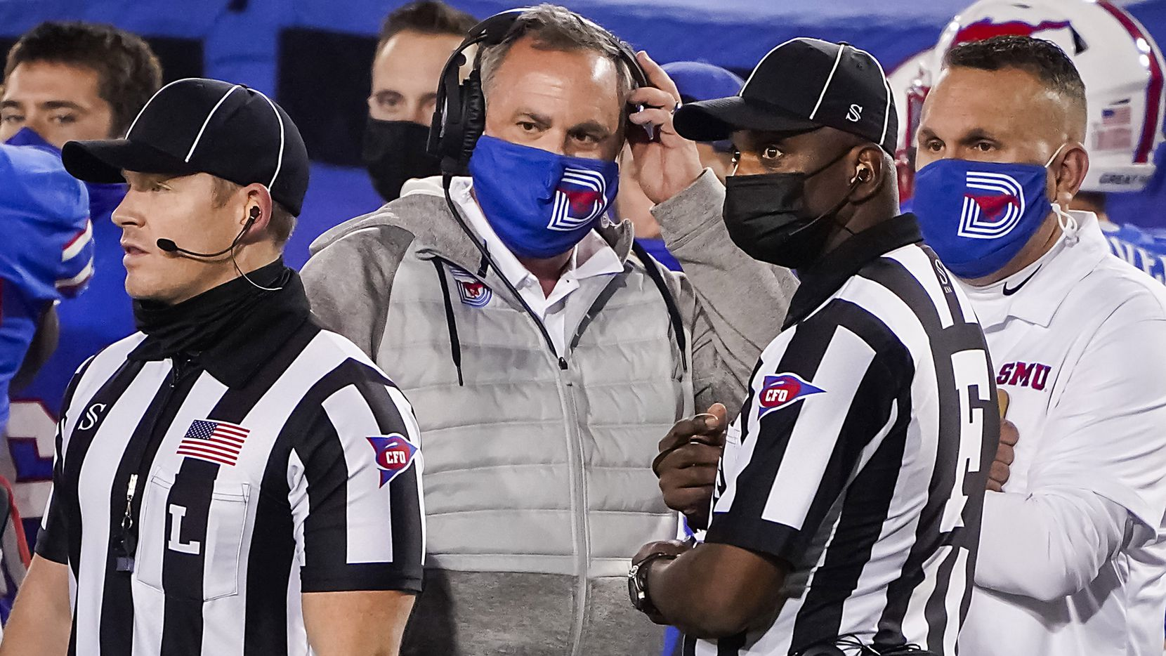 SMU head coach Sonny Dykes talks to officials during the fourth quarter of an NCAA football game against Navy at Ford Stadium on Saturday, Oct. 31, 2020, in Dallas.