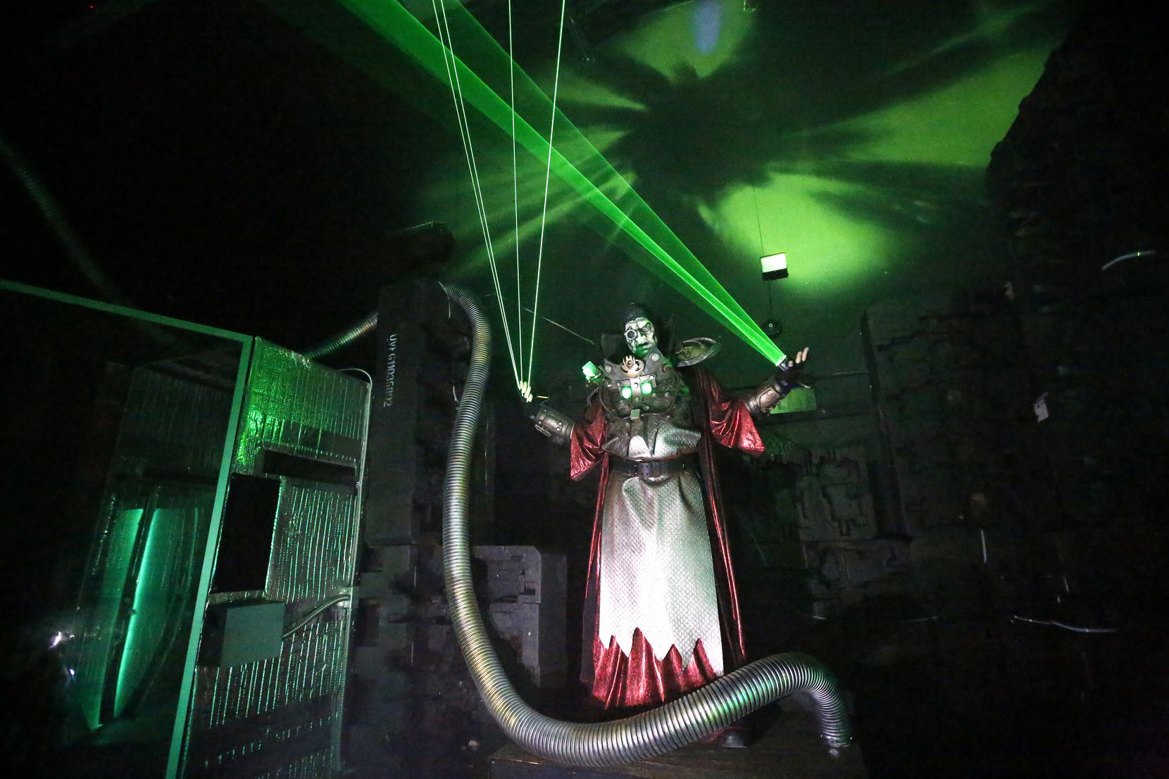 An actor performs during the Dark Hour Haunted House in Plano in 2017.