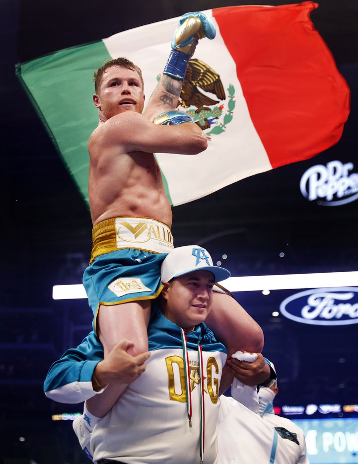 Boxers Canelo Alvarez celebrates after defeating Billy Joe Saunders in the eighth round of their super middleweight title fight at AT&T Stadium in Arlington, Saturday, May 8, 2021.  Sauders couldn't go on because he unsustained an eye injury and couldn't see. (Tom Fox/The Dallas Morning News)