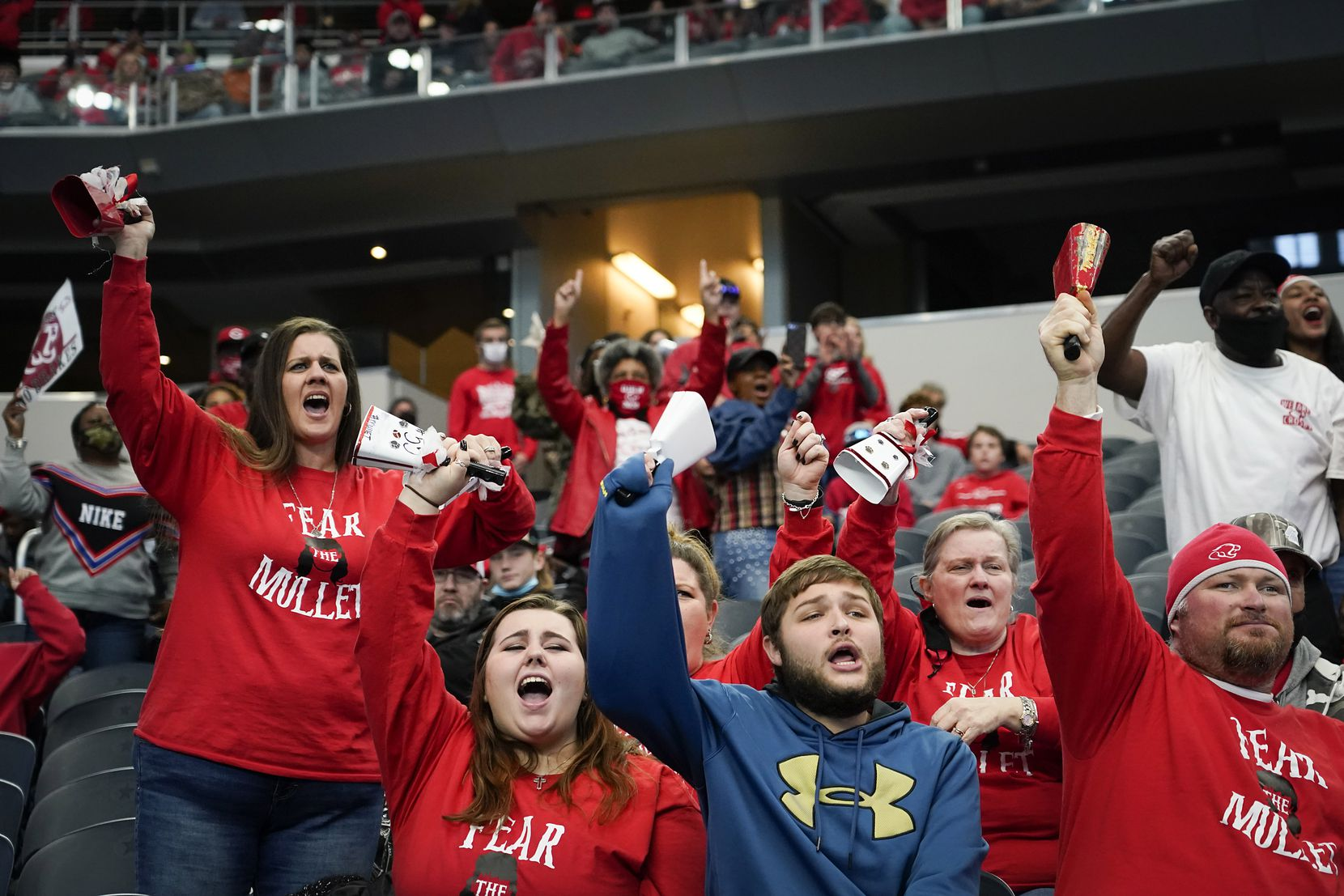 Crosby fans cheer their team during the first half of the Class 5A Division II state football championship game against Aledo at AT&T Stadium on Friday, Jan. 15, 2021, in Arlington. (Smiley N. Pool/The Dallas Morning News)