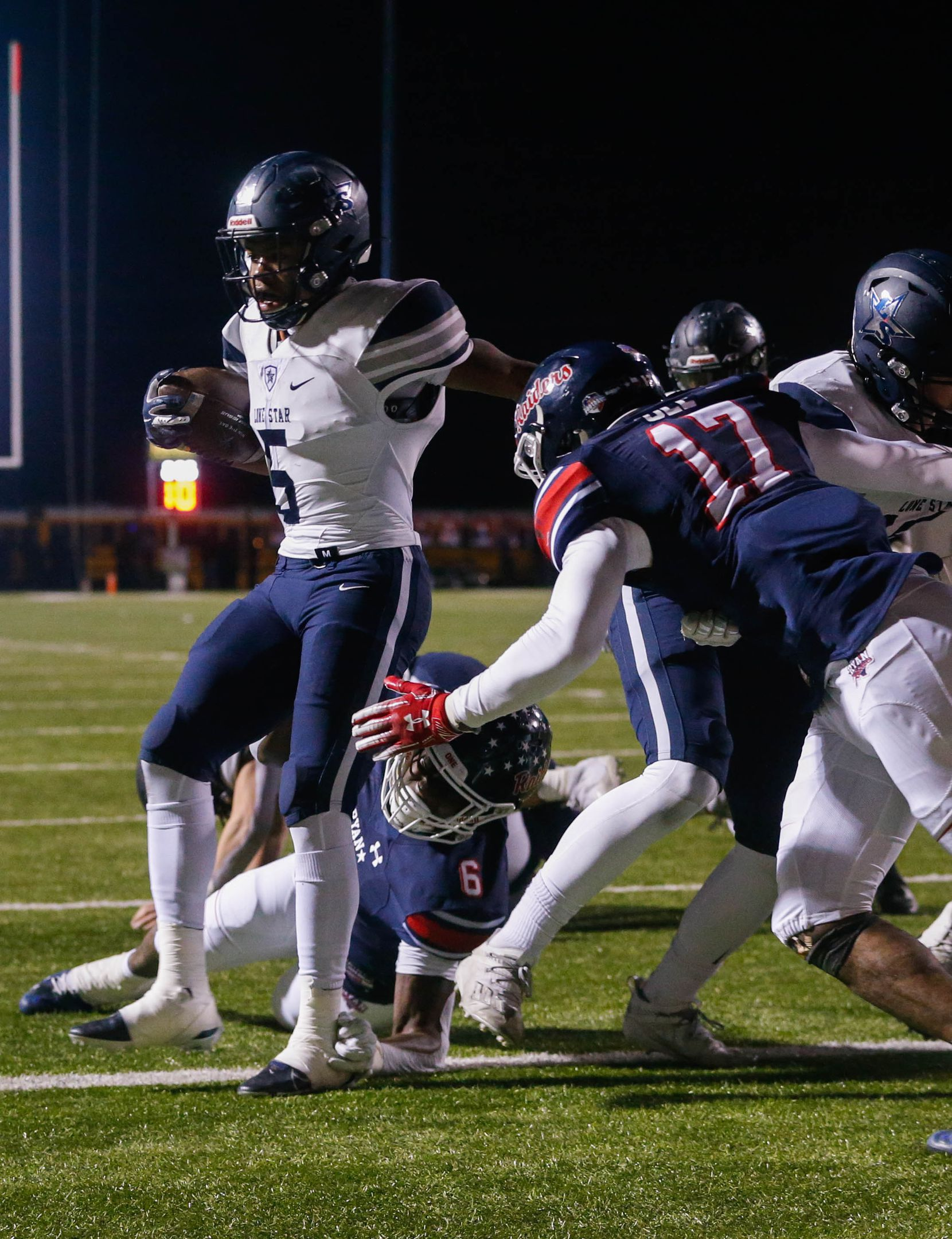 Frisco Lone Star's running back Jaden Nixon (5) scores a touchdown during the end of the second quarter of a football game against Denton Ryan at the C.H. Collins Complex in Denton on Thursday, Dec. 4, 2020. The game is tied at halftime, 14-14. (Juan Figueroa/ The Dallas Morning News)
