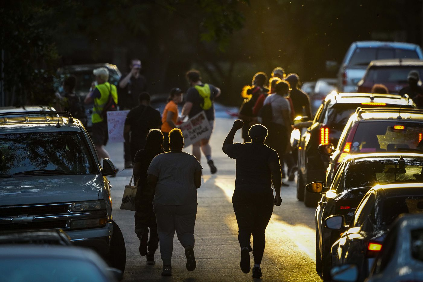 Marchers head down Elizabeth Street during a protest at Cole Park on Friday, June 5, 2020, in Dallas. Protests continued Friday in the response to the death of George Floyd.