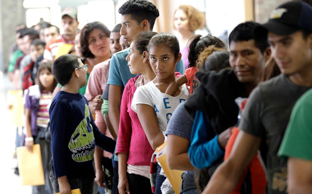Immigrants line up inside the bus station after they were processed and released by U.S. Customs and Border Protection, Friday, June 22, 2018, in McAllen, Texas.