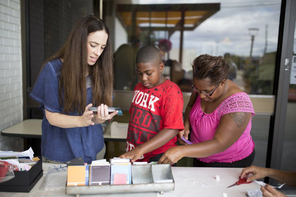 Kendrick Linnear (center), 11, of Dallas, and his mother Brandy Redwine (right) participate in a workshop lead by Artist Lisa Huffaker making zines during Make Art with Purpose at Dallas West Branch Library. (Ting Shen/The Dallas Morning News)