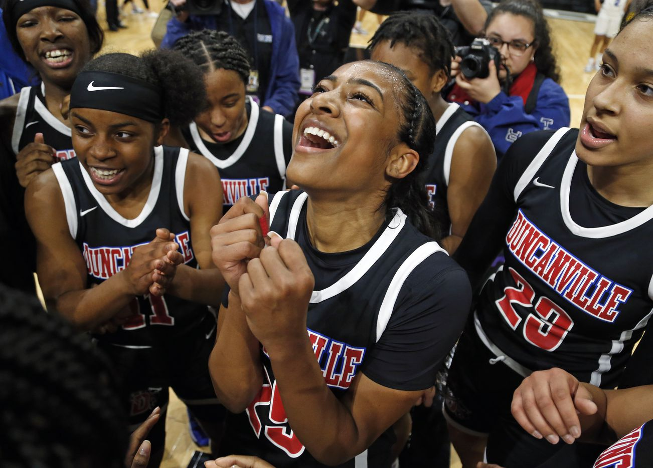 Duncanville guard Deja Kelly #25 celebrates with the rest of the team in a 6A final on  Saturday, March 7, 2020 at the Alamodome.