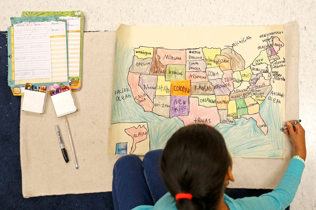 First-grader Marilyn Ibarra draws a U.S. map during a Lower Elementary General Education class at Mata Montessori in Dallas. (Jae S. Lee/The Dallas Morning News)