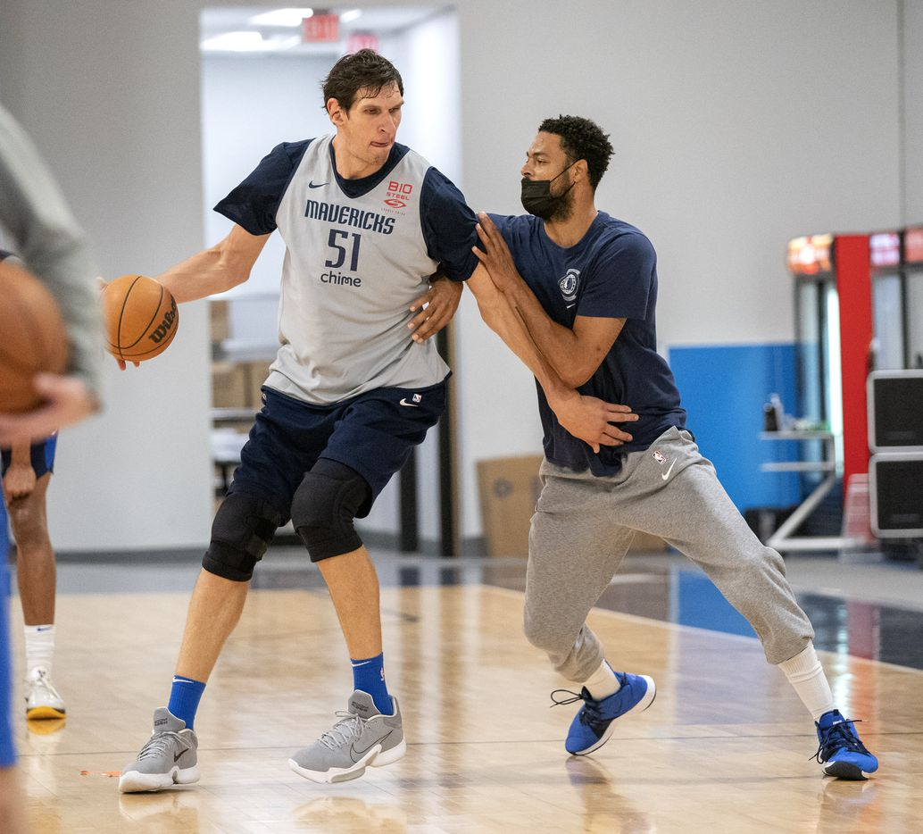 Dallas Mavericks center Boban Marjanović works against former Mavericks center Tyson Chandler during a training camp practice Wednesday, September 29, 2021 at the Dallas Mavericks Training Center in Dallas. Chandler, who played a key role on the Mavericks 2011 championship team, has been helping out at practices as he considers a future in coaching. (Jeffrey McWhorter/Special Contributor)