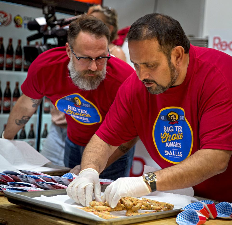 """Isaac Rousso (right) and Jacob Hunter take a look at freshly fried Cookie Fries before sending them out to judges during the 2016 Big Tex Choice Awards Sunday, August 28, 2016 at Fair Park in Dallas. The annual event, held ahead of the State Fair of Texas, recognizes the best fried foods entered into consideration for sale at the fair. Rousso and his team won """"Most Creative"""" for their entry.(G.J. McCarthy/The Dallas Morning News)"""