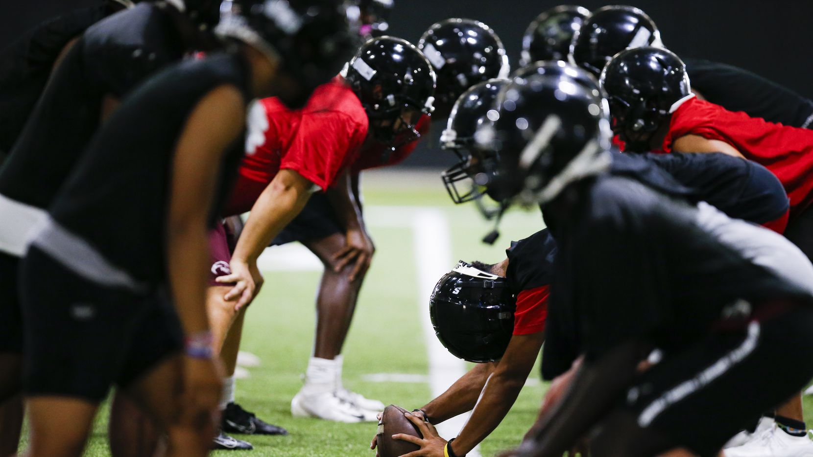 Euless Trinity's varsity football team runs drills during a practice at Euless Trinity High School, Monday, August 9, 2021. (Brandon Wade/Special Contributor)