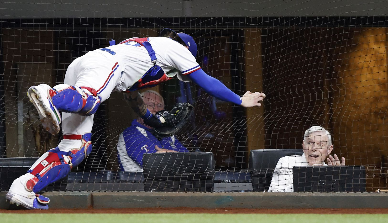 Texas Rangers co-owner and co-chairman Ray Davis reacts as Texas Rangers catcher Jonah Heim (28) attempts to catch an Oakland Athletics foul ball against the netting in the eighth inning at Globe Life Field in Arlington, Saturday, August 14, 2021.(Tom Fox/The Dallas Morning News)