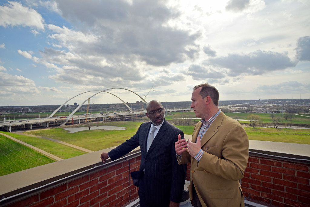 Dallas City Council member Philip Kingston (right) speaks with Dallas City Manager T.C. Broadnax as they look at a view of the Margaret McDermott Bridge and the Trinity River from the rooftop of the old Jesse R. Dawson State Jail in Dallas on March 06, 2017. The city officials visited the old jail to determine its viability as a possible homeless shelter.