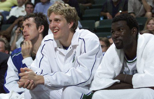 (Shot 5/1/2001) FILE --  DALLAS MAVERICKS VS. UTAH JAZZ NBA PLAYOFFS -- Mavericks Dirk Nowitzki is all smiles as he sits on the bench with teammates Steve Nash, left, and Michael Finley, right, in the final minute of game four against the Jazz.