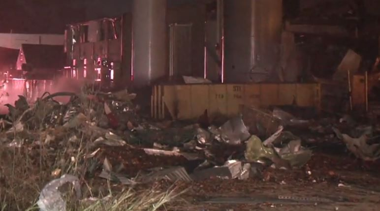 Debris litters an area near where an explosion occurred at a manufacturing plant Friday morning in Houston.