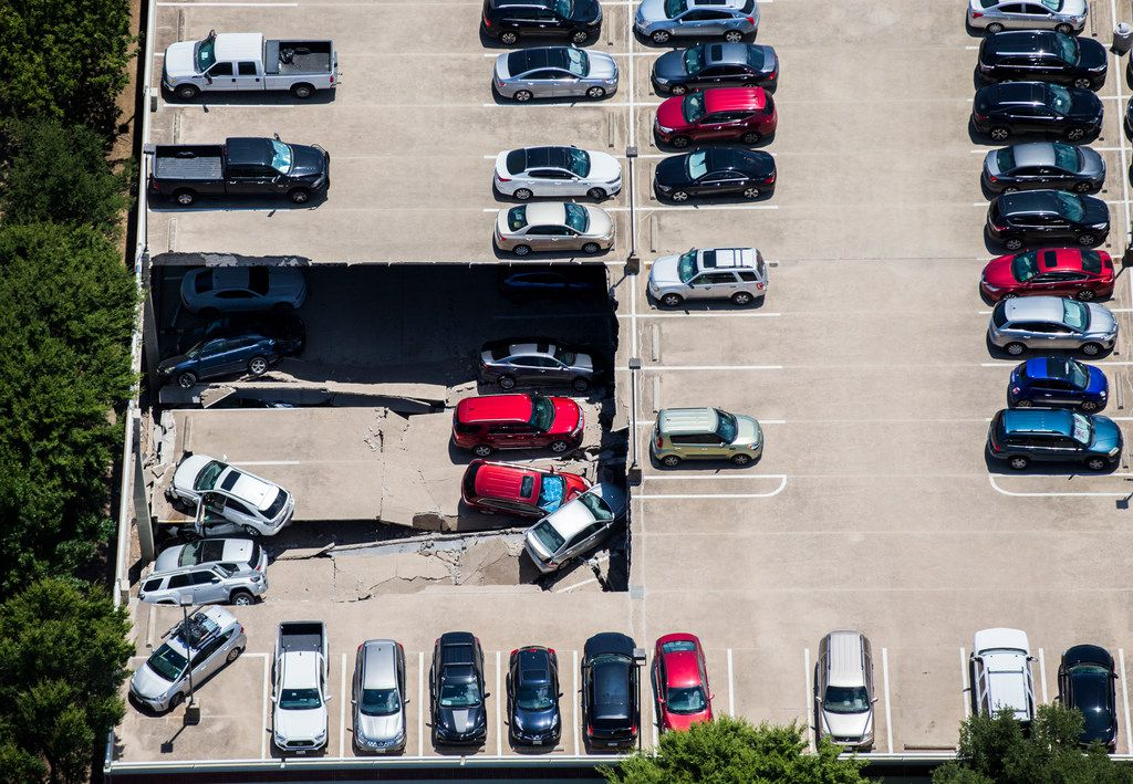 Emergency crews respond to a collapsed parking garage at 4545 Fuller Road in Irving on Tuesday.