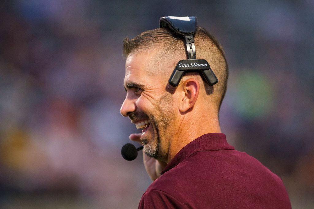 Mesquite head coach Jeff Fleener laughs on the sidelines during the first half of a high school football game against L.D. Bell on Thursday, Sept. 19, 2019, in Bedford, Texas. (Smiley N. Pool/The Dallas Morning News)