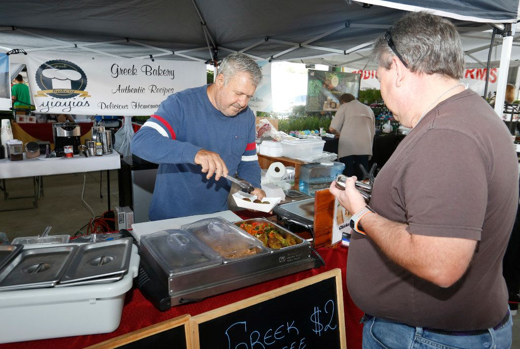 Greek Bakery owner Tony Davrados boxes up a gyro for Bill Marth of Waxahachie at the Dallas Farmers Market.