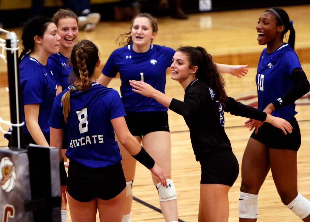 Trophy Club Byron Nelson outside hitter Paige Flicking (8) lights up the room (or at least half of it) as she ignites the energy early from Bobcats teammates after scoring early in the first game of their playoff match against Coppell. Also pictured from left are Payton Chamberlain (12), Nina Peterson (7), Eden Fusselman (1), Gia Santini (3) and Charitie Luper (10). Byron Nelson won in straight sets, 25-14, 25-21, 25-11 to advance. The two teams played their first-round Class 6A volleyball playoff match at Keller Central High School in Fort Worth on November 5, 2019. (Steve Hamm/ Special Contributor)