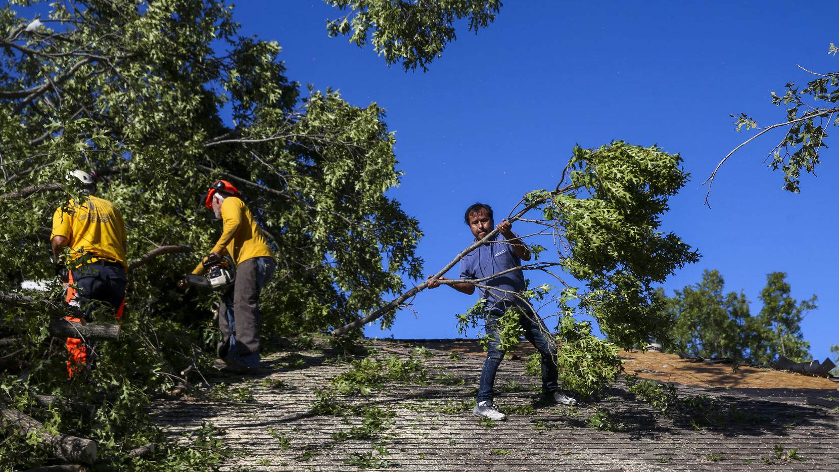 This file photo shows members of Texas Baptist Men and Islamic Relief USA clear tornado debris on Monday, October 21, 2019 in Richardson, Texas.