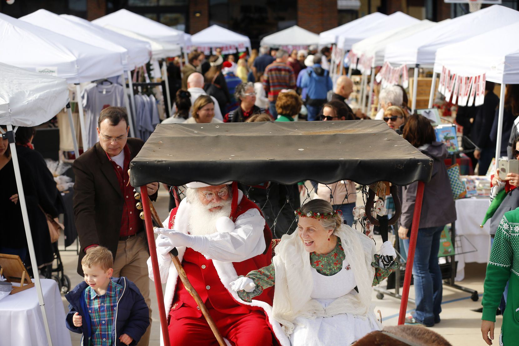Santa and Mrs. Claus ride in a pony-drawn carriage around Marché de Noël , an annual French Christmas market. This year's festival is Dec. 8.