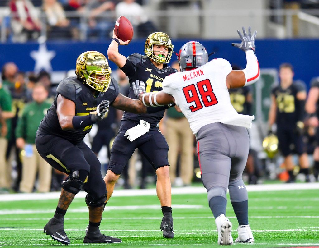 LUBBOCK, TX - NOVEMBER 11: Charlie Brewer #12 of the Baylor Bears looks to pass the ball while under pressure from Nick McCann #98 of the Texas Tech Red Raiders during the game on November 11, 2017 at  AT&T Stadium in Arlington, Texas. Texas Tech defeated Baylor 38-24. (Photo by John Weast/Getty Images)