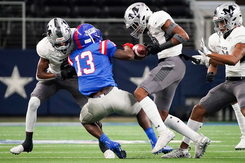 Arlington Martin linebacker Morice Blackwell Jr. strips the ball away from a Duncanville receiver during a Class 6A Division I Region I semifinal playoff football game at AT&T Stadium on Nov. 29, 2019. (Smiley N. Pool/The Dallas Morning News)