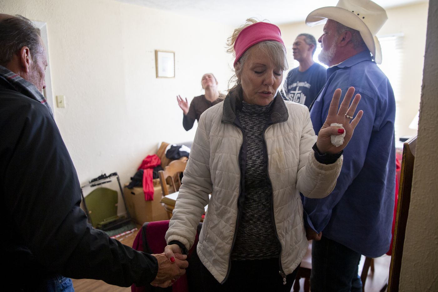 Jennifer Birdd prays with a member of the congregation in January on the first Sunday after S.O.U.L. Church lost its downtown Dallas lot.