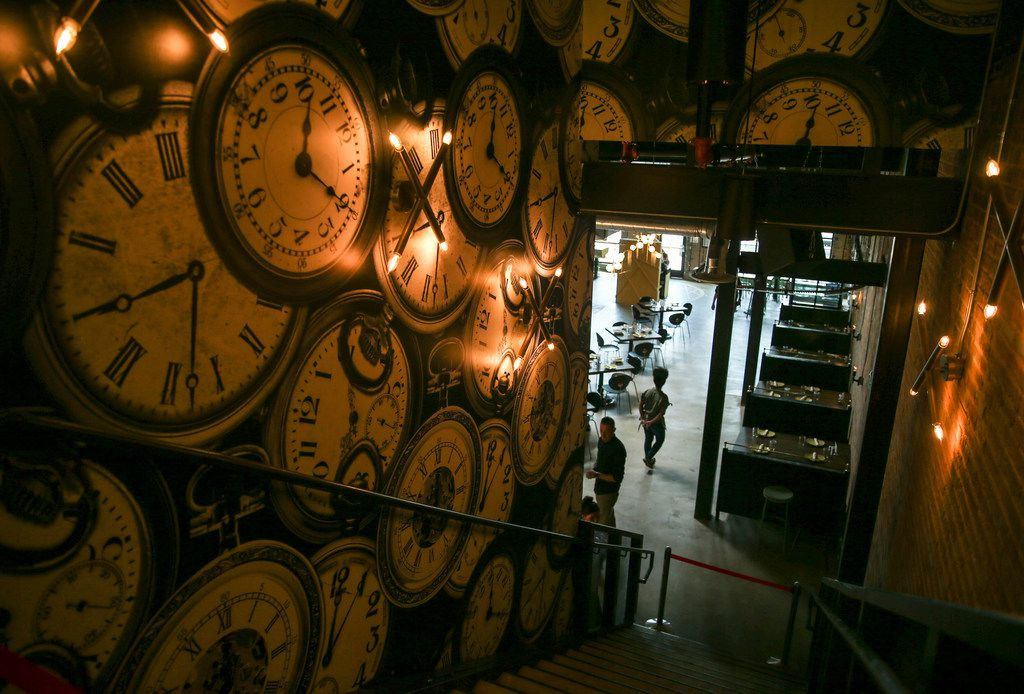 A stairwell adorned with pocket watch wall paper is seen at Punch Bowl Social on Thursday, June 27, 2019 in Dallas. (Ryan Michalesko/The Dallas Morning News)