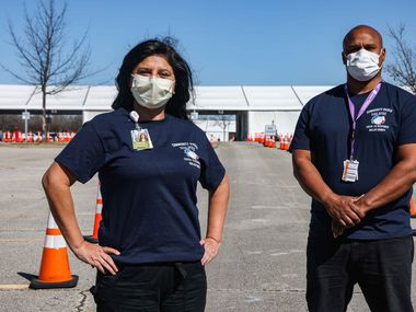 Samia Zia and Herron Mitchell, Parkland Hospital executives, poses at Parkland Health & Hospital System's COVID vaccine and testing location at Ellis Davis Field House in Dallas on Wednesday, March 3, 2021. (Lola Gomez/The Dallas Morning News)