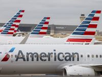American Airlines planes parked at Terminal D at DFW International Airport.