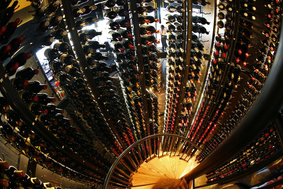 The wine tower (as viewed from the top of the rotating stairwell with a fisheye lens) houses more than 2,000 bottles at the new Del Frisco's Double Eagle Steak House in Dallas. The entire restaurant holds about 5,000 bottles.