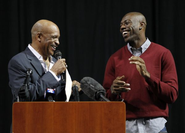 "Allen Wranglers general manager Drew Pearson shares a laugh with Terrell Owens during the ""Allen Wranglers Welcoming Party for #81, Terrell Owens,"" at Allen Events Center in Allen, on February 8, 2012. Owens is now co-owner and player for the Allen Wranglers IFL team."