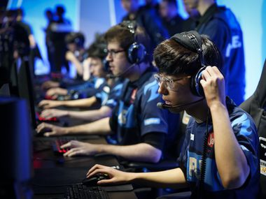 "Jung ""Closer"" Wonsik of the Dallas Fuel puts on his headphones as he prepares for the start of a Overwatch League match against the Los Angeles Valiant at the Arlington Esports Stadium on Saturday, Feb. 8, 2020, in Arlington, Texas (Smiley N. Pool/The Dallas Morning News)"
