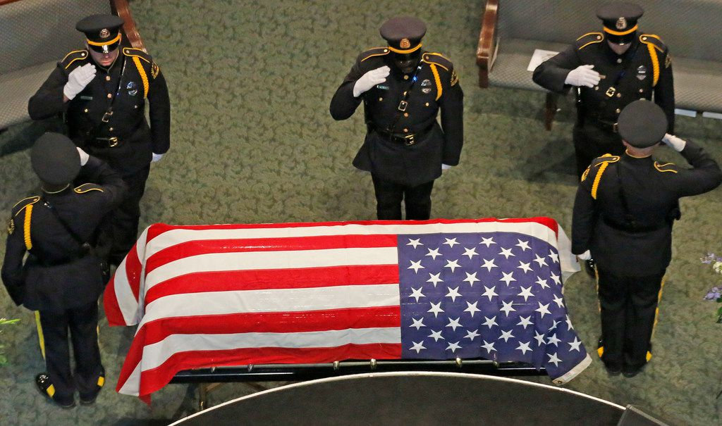 """An honor guard changes as they stand vigil at the casket of Dallas Police Department Senior Cpl Earl James """"Jamie"""" Givens before his funeral, held at Prestonwood Baptist Church in Plano, Texas on Thursday, July 26, 2018. (Louis DeLuca/The Dallas Morning News)"""