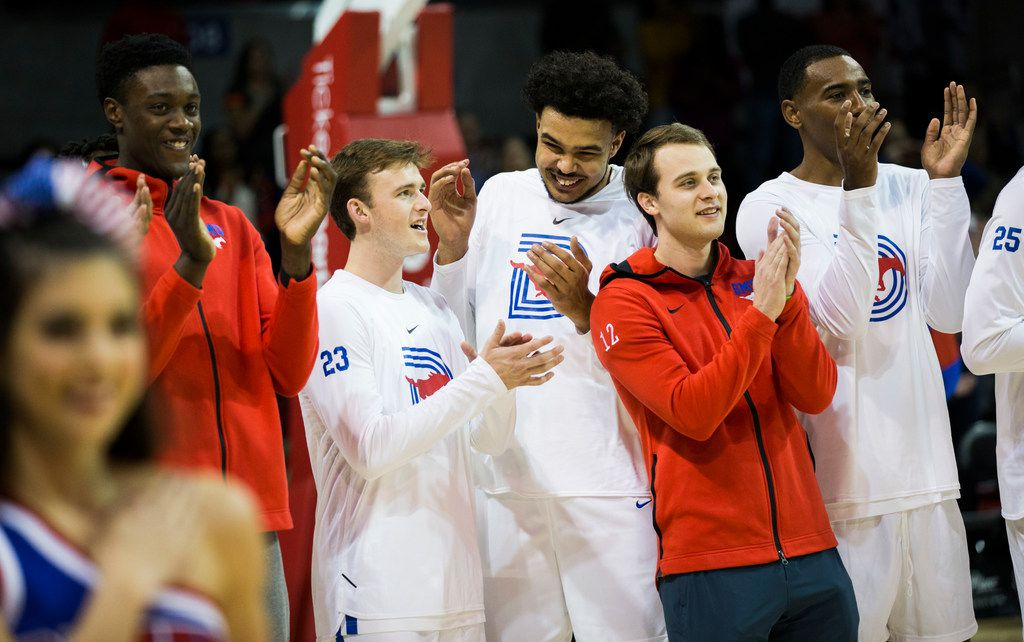 Southern Methodist Mustangs applaud after Lila Tran sang the national anthem before a basketball game between SMU and University of Houston on Saturday, February 15, 2020 at Moody Coliseum in Dallas. (Ashley Landis/The Dallas Morning News)