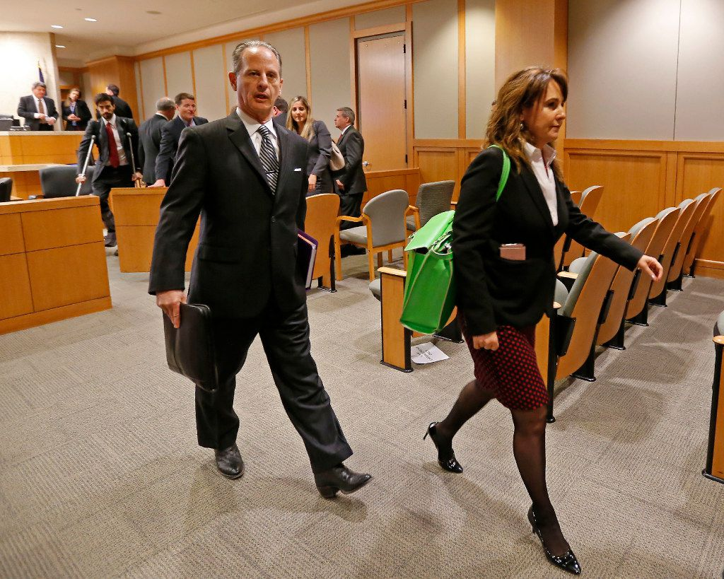 Special prosecutors Brian Wice (left) and Nicole DeBorde leave a courtroom after a Texas Attorney General Ken Paxton's hearing at Collin County Courthouse in McKinney on Feb. 16.