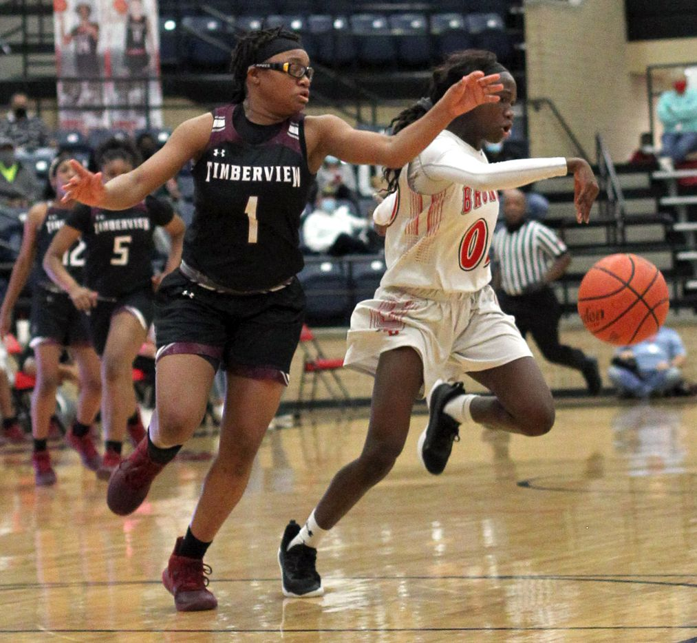 Mansfield Timberview's Tamaiya Mims (1) chases Mansfield Legacy guard Coniah Cooley (00) after she won a battle for ball control during the second half of play. The two teams played their District 8-5A girls basketball game at Mansfield Legacy High school on January 22 , 2021. (Steve Hamm/ Special Contributor)