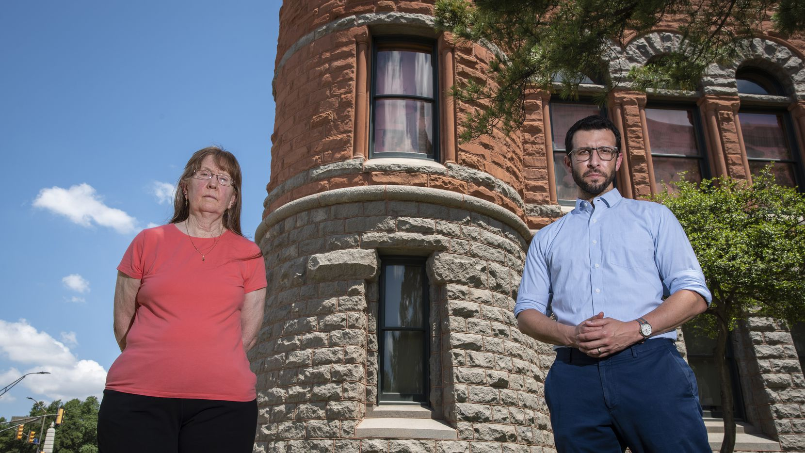 Sally Dobbie, left, and Chris Dowdy, vice president of academic affairs at Paul Quinn College, outside the Old Red Museum of Dallas County History and Culture in downtown Dallas. Dobbie and Dowdy are asking the state  to place a historical marker commemorating the lynching of Allen Brooks in 1910. The window between the two on the second floor of the museum is the location where Allen Brooks was pushed out the window with a rope around his neck. He was dragged along Main Street and later hung in front of a crowd of thousands.