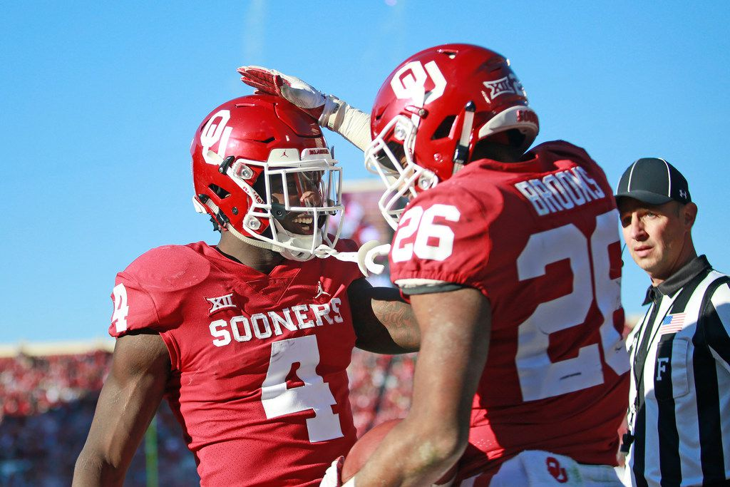 NORMAN, OK - NOVEMBER 10: Running back Trey Sermon #4 congratulates running back Kennedy Brooks #26 of the Oklahoma Sooners on a score against the Oklahoma State Cowboys at Gaylord Family Oklahoma Memorial Stadium on November 10, 2018 in Norman, Oklahoma. Oklahoma defeated Oklahoma State 48-47. (Photo by Brett Deering/Getty Images)