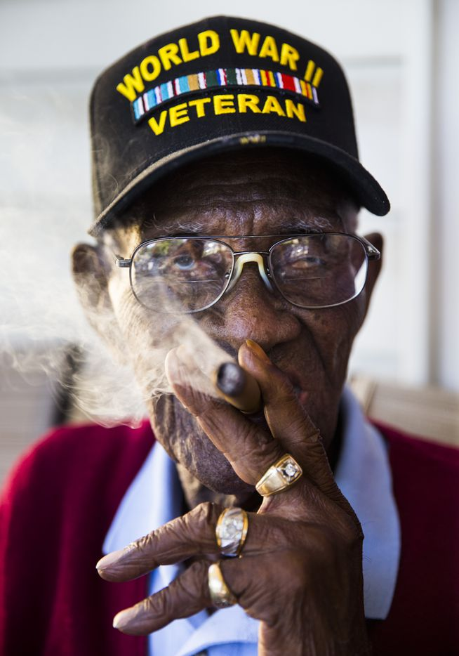 Richard Overton, 111, smokes a cigar on his front porch on May 25, 2017, in Austin. Overton is known for smoking cigars and drinking whiskey on his front porch.