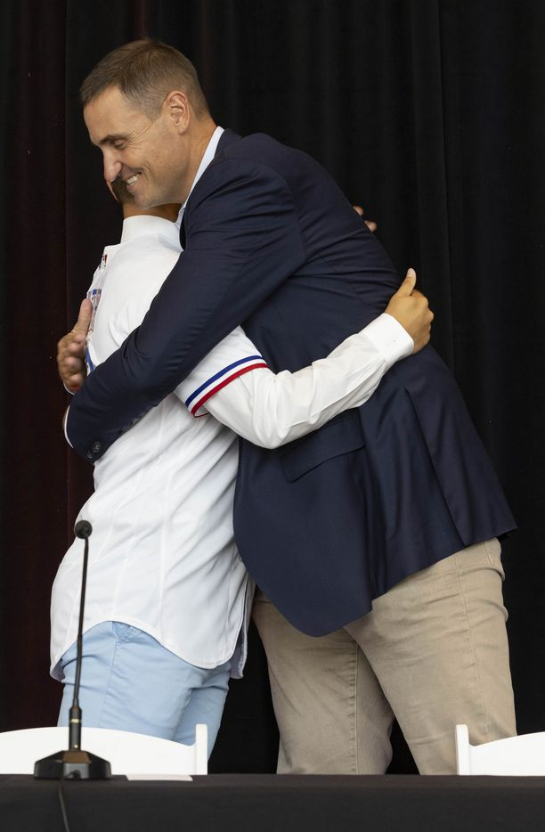 Chris Young, Rangers Executive Vice President and General Manager, congratulates Jack Leiter from Vanderbilt University after putting on his Texas Rangers jersey following the announcement of his signing on Tuesday, July 27, 2021, at Globe Life Field in Arlington. Leiter was the club's 2021 MLB Draft first round selection and the draft's second overall pick. (Juan Figueroa/The Dallas Morning News)