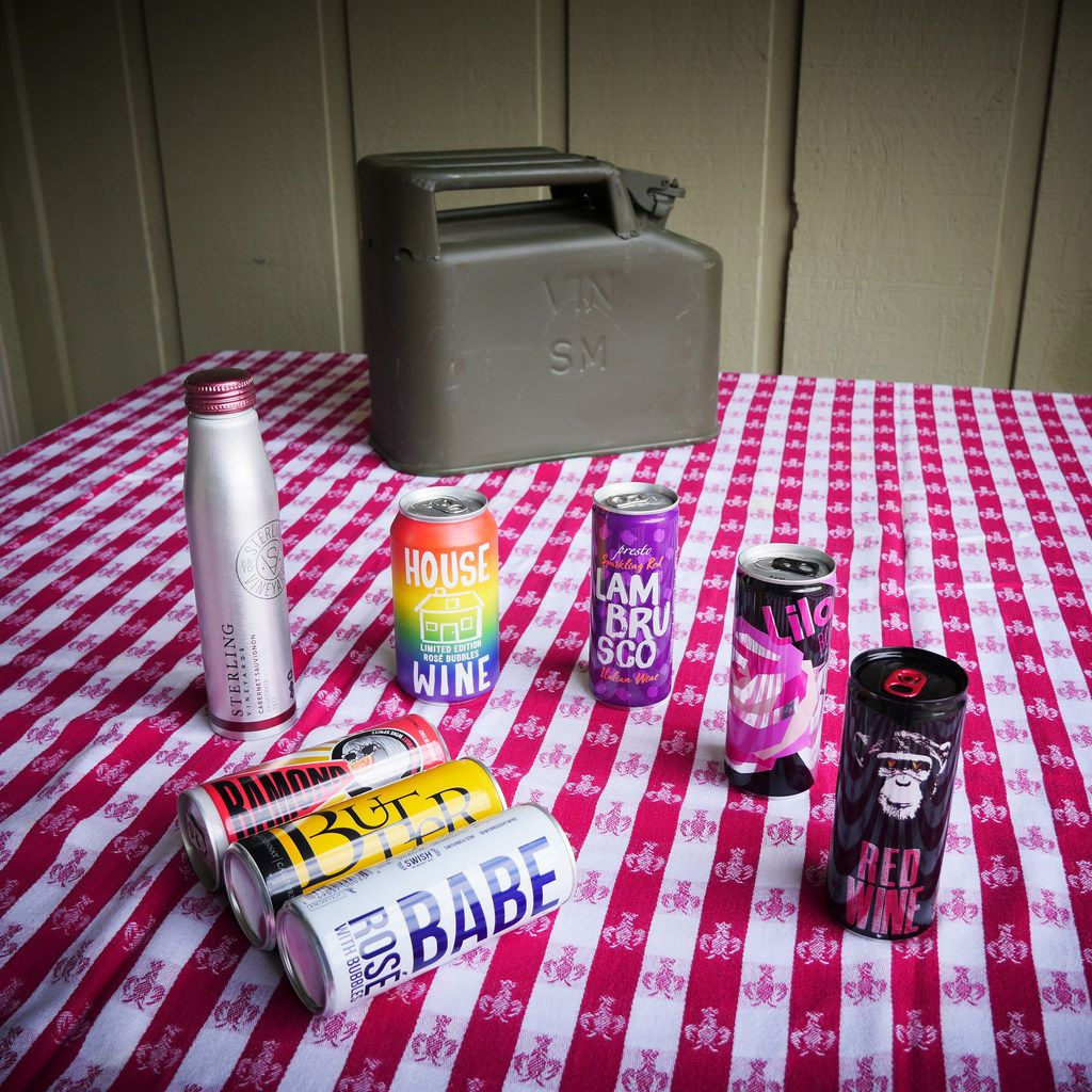 Various canned wines are pictured with a vintage French army wine can.