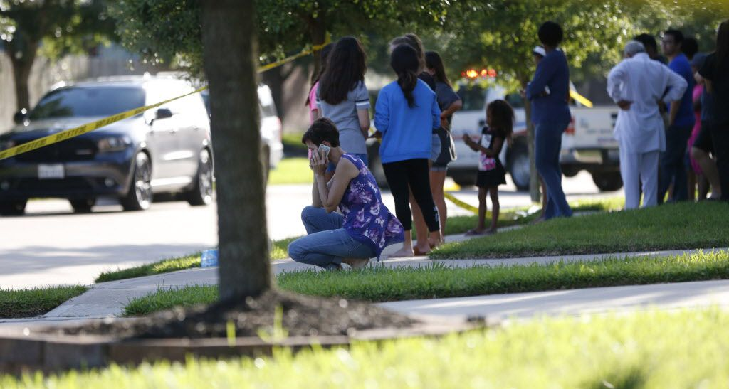 Neighbors gathered to watch Friday as the Fort Bend County Sheriff's Office investigated a shooting in Katy where Christy Byrd Sheats fatally shot her two adult daughters before being killed by police.
